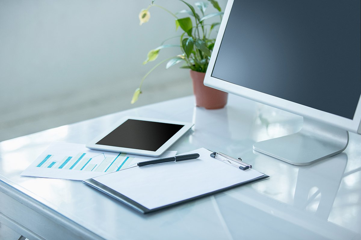 Desktop with marketing materials and tablet