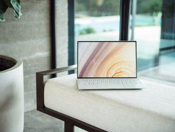 Laptop sitting on bench
